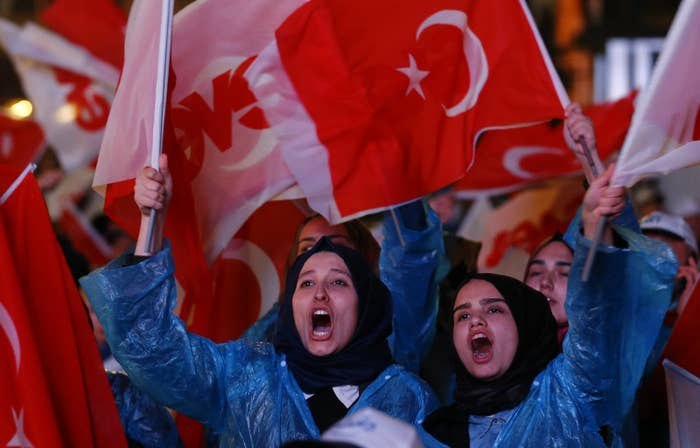 Supporters of AK party react at the party headquarters in Ankara.