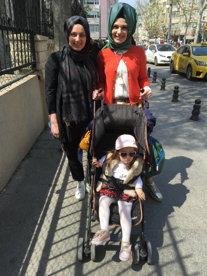 """Beyza Sensoy, 20, left, voted """"No"""" in Turkey's constitutional referendum while her sister Sude, 34, voted """"Yes."""" They posed outside a voting station Istanbul's Kadikoy district on Sunday, April 16, 2017."""