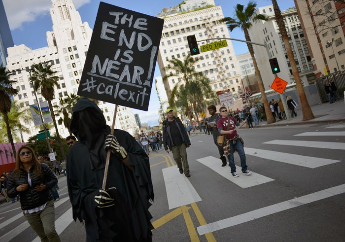 """A demonstrator holds a """"Calexit"""" sign at the Women's March on January 21 in Los Angeles."""