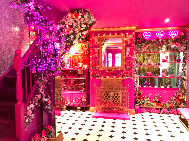 "Now, maybe you're thinking, ""A pink house? Come on, give me something to CHEW ON."" Well lucky for you, the interior of the house DELIVERS. For instance, here's the entryway that greets you the second you walk through the Pepto-pink door."