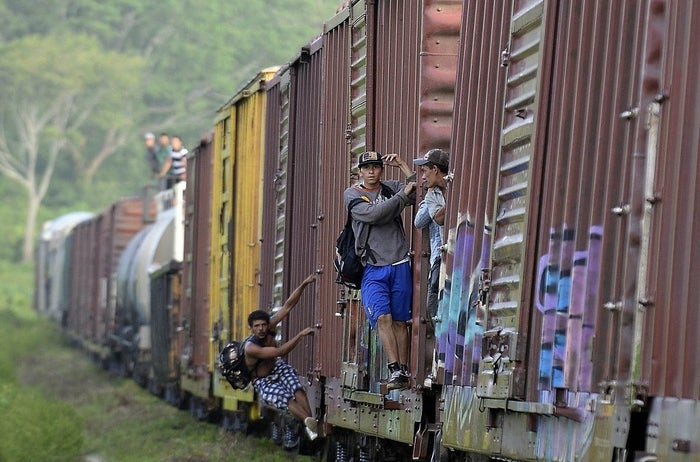 Migrants are seen on board of a train in Chiapas state, Mexico, on their way to the United States.