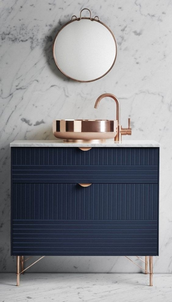 This rose gold sink and faucet atop a navy blue stand that is so flawless, it kind of makes me want to cry.