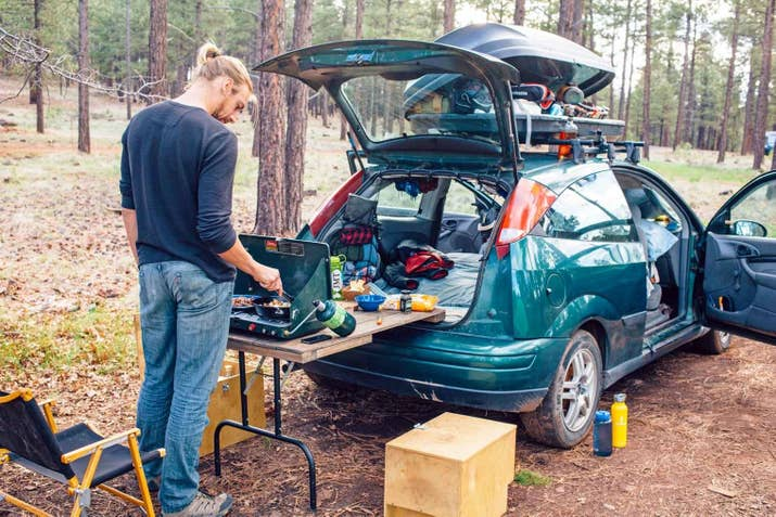 Balance A Foldable Camping Table On Your Bumper To Create Kitchen In Small Campsite