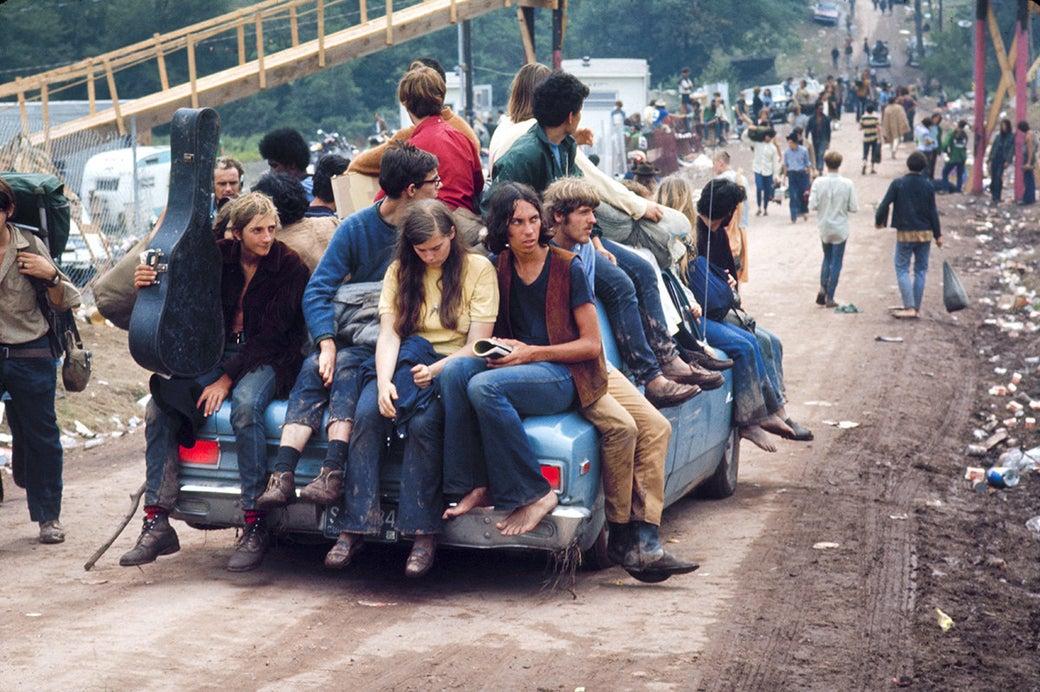 A group of hippies catch a ride to Woodstock in 1969.