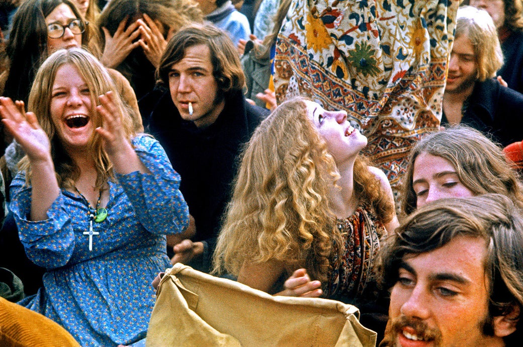 People in the crowd cheer as musical acts perform at the Altamont Speedway Free Festival on Dec. 6, 1969, in Livermore, California.