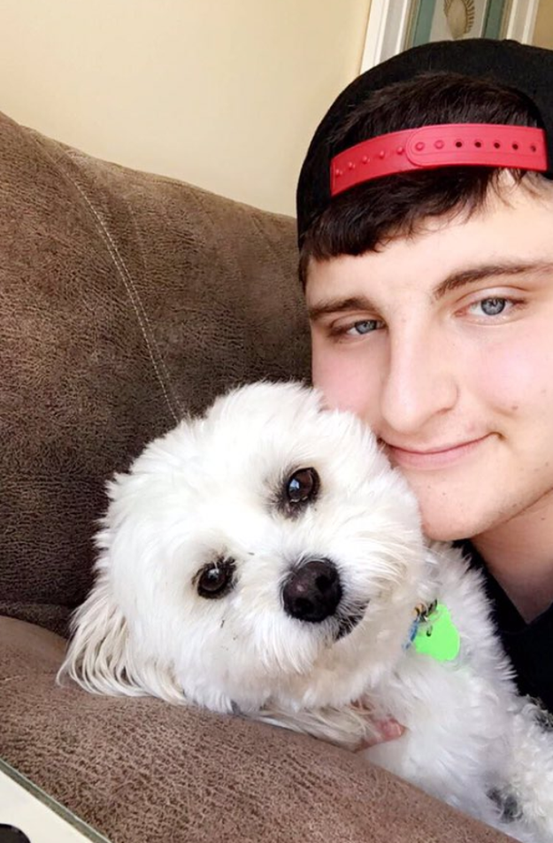 This is Joey Sweren, 19, and his dog, Buddy (left).
