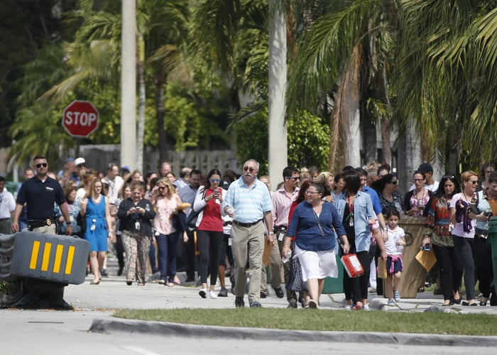 People evacuated because of a bomb threat return to the David Posnack Jewish Community Center and David Posnack Jewish Day School, Monday, Feb. 27, 2017, in Davie, Fla.