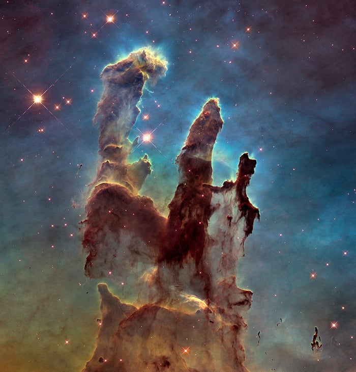The towering pillars are about five light-years tall and are made of cold hydrogen gas laced with dust. Stars are being born deep inside the pillars, and streams of gas bleed off as the intense radiation heats and evaporates the gas into space. The pillars are part of a small region of the Eagle Nebula, a vast star-forming region 6,500 light-years from Earth.