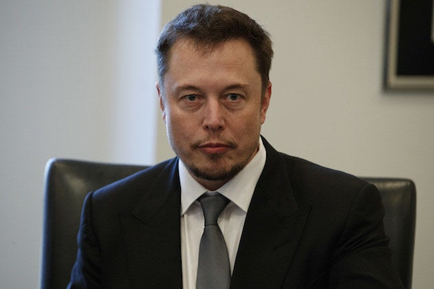 Tesla CEO Elon Musk listens as Donald Trump speaks during a meeting with technology industry leaders at Trump Tower in New York, Dec. 14, 2016.
