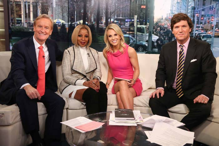 Steve Doocy, Mary J. Blige, Elisabeth Hasselbeck, and Tucker Carlson on the set of Fox & Friends in 2015.