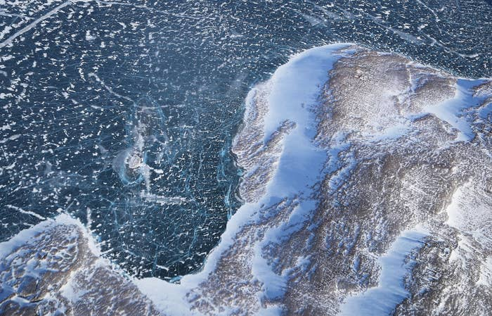 Sea ice meets land as seen from NASA's Operation IceBridge research aircraft along the Upper Baffin Bay coast on March 27, 2017 above Greenland. Greenland's ice sheet is retreating due to warming temperatures.