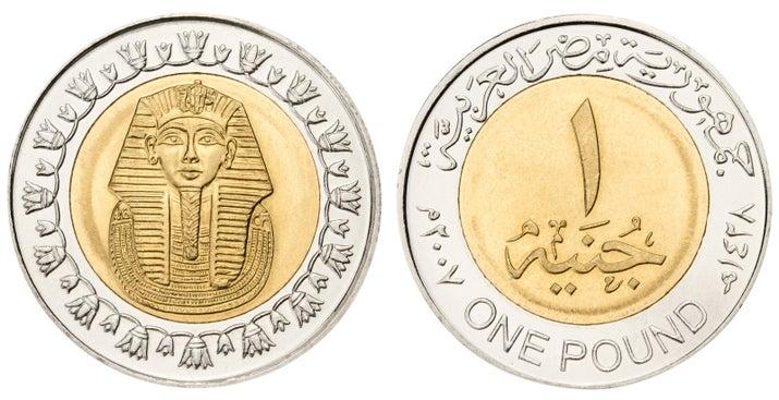 Один фунт монеты в Египте (выше) функции знаковых маска Тутанхамона.