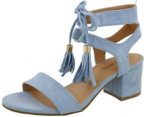 7c21e5006c8d A set of stacked sandals that won t be a ~tassel~ to your evening.