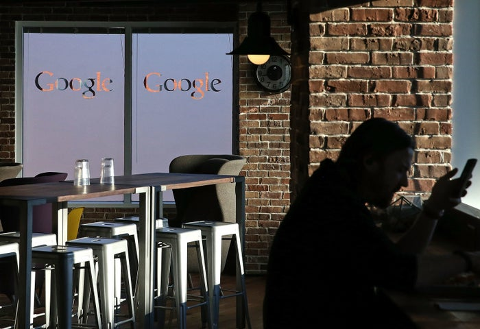 An employee sits in the cafeteria of Google's Washington, DC headquarters.