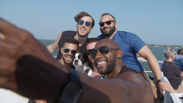 The cast of Fire Island take a group selfie.