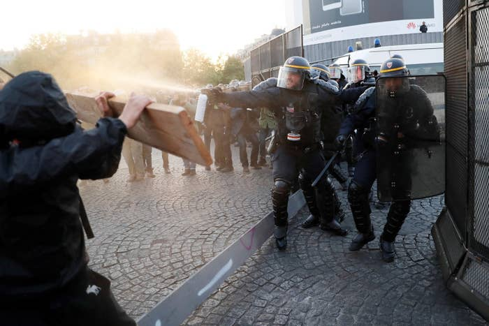 Protesters clash with police as they demonstrate in Paris on Sunday.