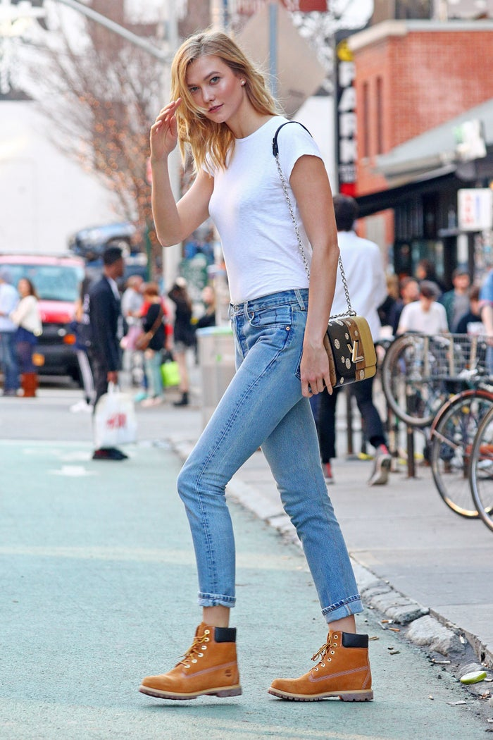 """After pics of Karlie Kloss wearing classic Timbs surfaced, Vogue dropped the headline """"Karlie Kloss Has a Fresh New Spring Shoe Idea—And You Might Already Own a Pair."""" The fashion outlet wrote, """"Kloss took the boots' down-home vibe and ran with it in light-wash blues casually cuffed at the ankle and a tiny white T-shirt—a look as all-American as she is."""" The story sparked confusion among black women, as a white tee, snug jeans and Timberlands have been the unofficial I-don't-have-time-but-I'm-still-trying-to-be-cute getup for as far back as our memories take us. Wheat (the """"signature yellow"""" color Vogue referred to) Timbs have been a style staple in communities of color since the glory days of hip-hop, so the """"new idea"""" was a thing long before Karlie Kloss was Karlie Kloss."""