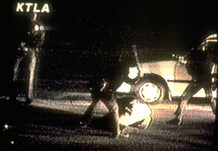 LA police officers beat Rodney King in this image from a video taken by George Holliday from his apartment overlooking the street.
