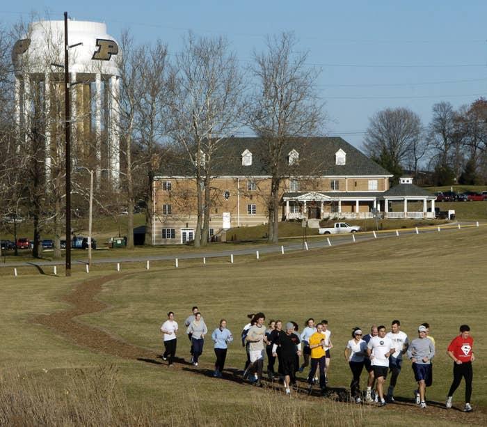 Joggers run through the Purdue University campus in Indiana.