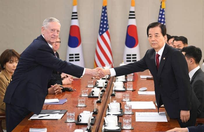 US Defense Secretary James Mattis (L) shakes hands with South Korean Defense Minister Han Min-Koo in Seoul in February