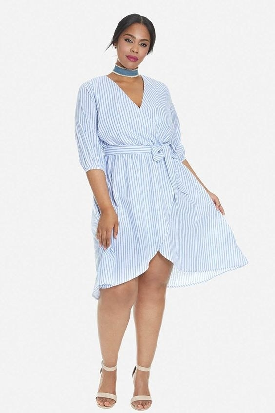 A striped wrap dress with a darling v-cut and waist tie perfect for summer boardwalk adventures.