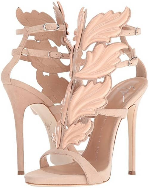 8a6dc5015afb These Giuseppe Zanotti metal wing sandals because you re gonna need wings  to get to the heights these shoes will take you.