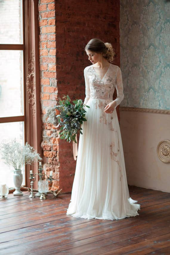 ef4d35c162af A lace and tulle gown with floral sequin embellishments and a button-down  back closure. Get it from AlexVeil Bridal on Etsy ...
