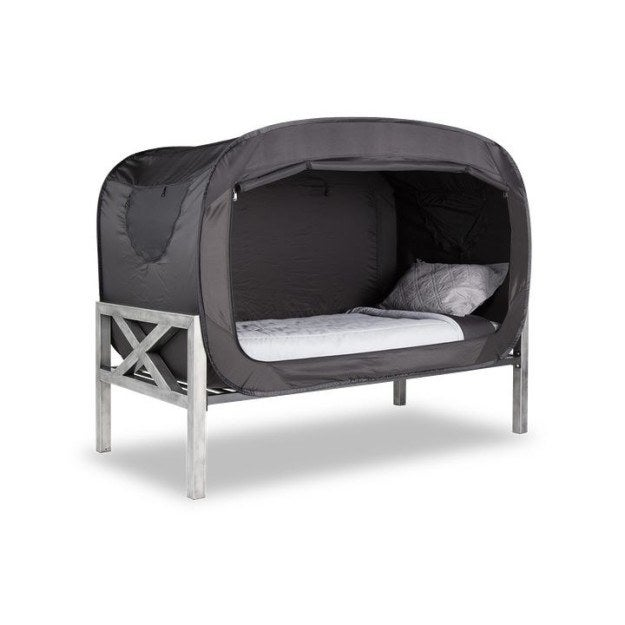 Most promising review: 'This is perfect for any college student or kid who just likes to have their own quiet space. This is tall enough to sit up in, but a cozy fort-like spot for my daughter to have some quiet space. It blocks out light nicely and is warm and cozy in her room, which can get chilly at night. Windows are also located at the top and bottom of the bed, which serve as doggy doors for us so our labs can get in and snuggle at night.' —Jennifer BerkheimerPrice: $129.99