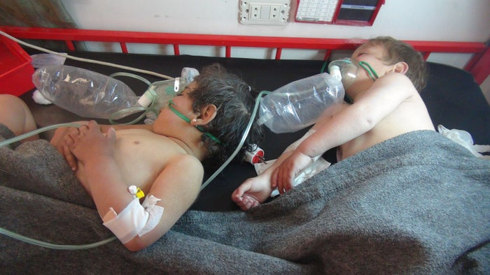 Children get treatment at a hospital after a suspected chemical attack.