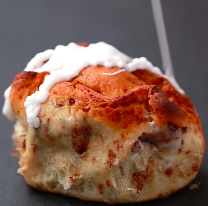 Servings: 6INGREDIENTS2 packs cinnamon roll dough with icing8 ounce block of cream cheese¼ cup granulated sugar½ teaspoon vanilla extract½ cup milkPREPARATION1. Preheat oven to 400°F/200˚C.2. Take two cinnamon roll dough pucks and press them flat into circles.3. In a medium bowl, mix together the cream cheese, sugar, and vanilla, stirring until smooth.4. Add the milk and stir until there are no lumps.5. Freeze cream cheese mixture for about 1 hour until frozen but not too hard.6. Scoop out a large spoonful of the mixture and place it in the center of one of the cinnamon roll dough circles.7. Fold the edges of the dough up the sides of the cream cheese scoop.8. Place the other flattened dough circle on top, using a spoon to tuck the edges underneath.9. Repeat with the remaining dough and cream cheese.10. Place the sealed dough balls upside down in a 9x9 cake pan with the seams facing upward. 11. Bake for 20–25 minutes until the rolls are golden brown and puffed.12. Drizzle the reserved icing on top of the rolls, and serve while warm!