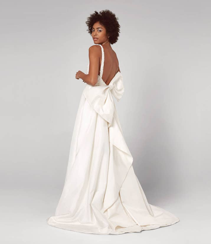 24 And A Gorgeous Oversized Silk Taffeta Bow That Leaves Lasting Impression On The Back Of This Ivory Fit Flare