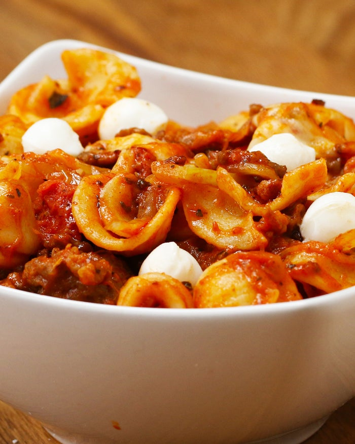Servings: 8INGREDIENTS1 pound hot Italian sausage1 large onion, sliced thin5 garlic cloves, sliced1 fennel bulb, sliced thin1 tablespoon dried oreganoSalt, to tastePepper, to taste6 ounces tomato paste14.5 ounces canned chopped tomatoes1 pound cooked orecchiette pasta ½ cup shaved parmesan1 cup mozzarella pearls PREPARATIONAdd the sausage to a large pot on medium high. Cook until browned. Remove temporarily from the pot. Add sliced fennel, onion, garlic, oregano, salt and pepper. Cook until the onions and fennel are golden and caramelized. Add the meat back into the pot. Add the tomato paste, stir, and cook until the tomato paste has darkened and is aromatic. Add the chopped tomatoes. Bring to a boil, reduce to simmer, and cook until the sauce thickens slightly. Add the cooked pasta, the grated parmesan, and the mozzarella pearls. Stir until well combined and heated through. Garnish with fennel fronds, (the green leaves of the fennel bulb) and enjoy!