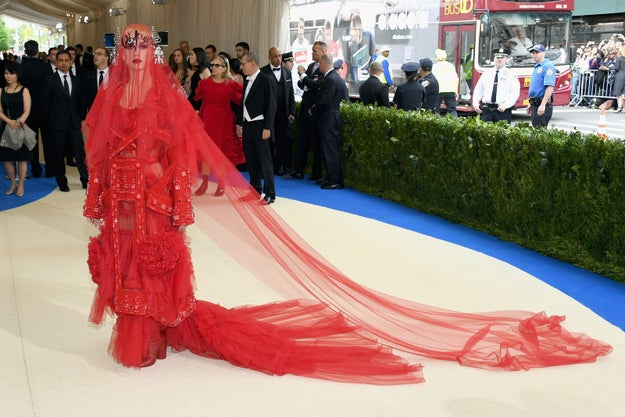 Listen, you've been on BuzzFeed before so you know how this works. Katy Perry wore this red number to Monday's Met Gala, and regardless of whether or not she looked stunning, people on Twitter immediately began saying she looked like this or that because that's how social media works.