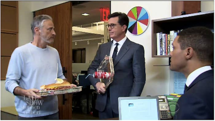 """""""I don't have time for this today, man, I have a show to do,"""" Noah says.""""Me too,"""" Colbert replies, while Stewart looks around for a distraction."""