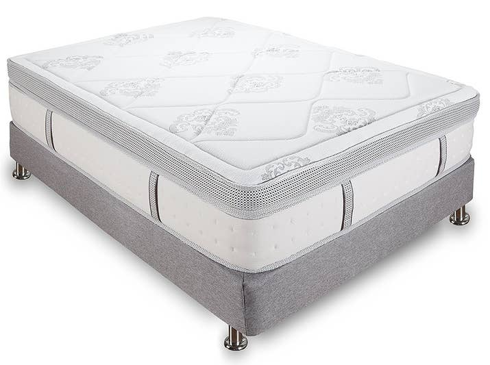 "Promising Review: ""I went to brick and mortar stores in town and laid on several types of beds to determine that most memory foam was not supportive enough for my taste. Therefore I decided on the hybrid bed, which includes a good amount of memory foam on the top layers, while still having a supportive coil system on the bottom. I have been using this mattress for several months now. I have never slept better. Yes the mattress is firm and supportive, however it does have a plush feel to it at the same time. You do not sink into the mattress. My back no longer hurts when I wake up."" —HeyYouPrice: $316.80+ Sizes: twin XL, full, queen, king, and California kingThickness: 14-inchTry it with this low-profile box spring for $85.25+ (available in sizes twin, twin XL, full, full XL, queen, king, and California king) and heavy duty frame for $73.60+ (available in sizes twin, twin XL, full, queen, king, and California king)."
