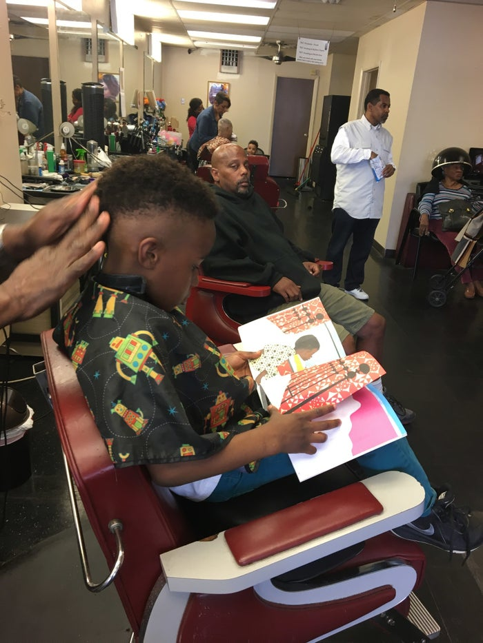 """""""We leverage the cultural significance of barbershops in black communities to increase boys' access to culturally relevant, age appropriate, and gender responsive children's books and to increase out-of-school time reading among young black boys."""""""