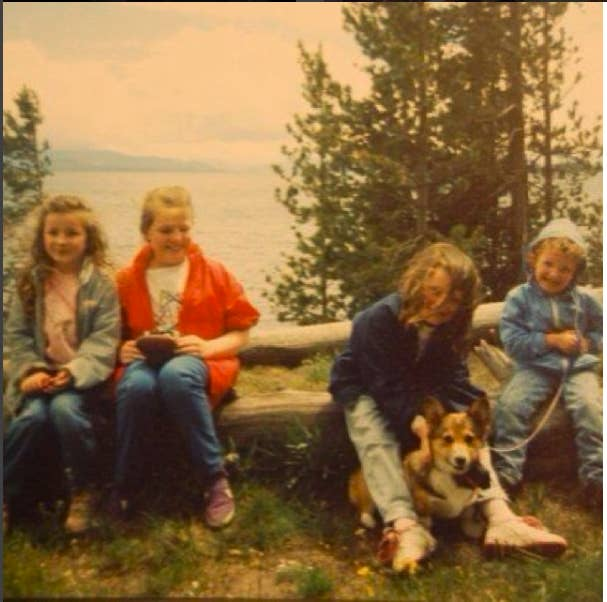 Eileen at Yellowstone holding onto the family corgi.