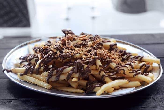 The fries are drizzled with Nutella and topped with crushed hazelnuts because life is beautiful sometimes.
