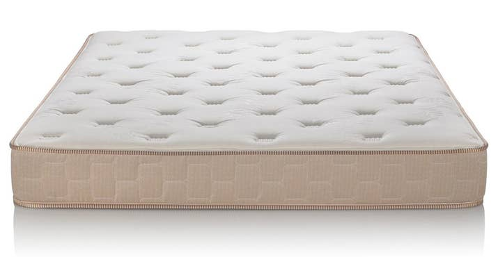 """Promising Review: """"The height is perfect, true to description. The firmness is just what I wanted. The mattress is very comfortable. I tend to have one extremity or another hanging off the bed so the height is great for my dramatic sleeping style. I prefer soft beds over unnecessarily firm ones and this gives you the soft with the support."""" —AJ JohnsonPrice: $140.81+ Sizes: twin XL, full, and queen Colors: beige and grayThickness: 10-inchTry it with this decorative white metal frame for $91.04+ (available in twin and queen). No box spring required."""