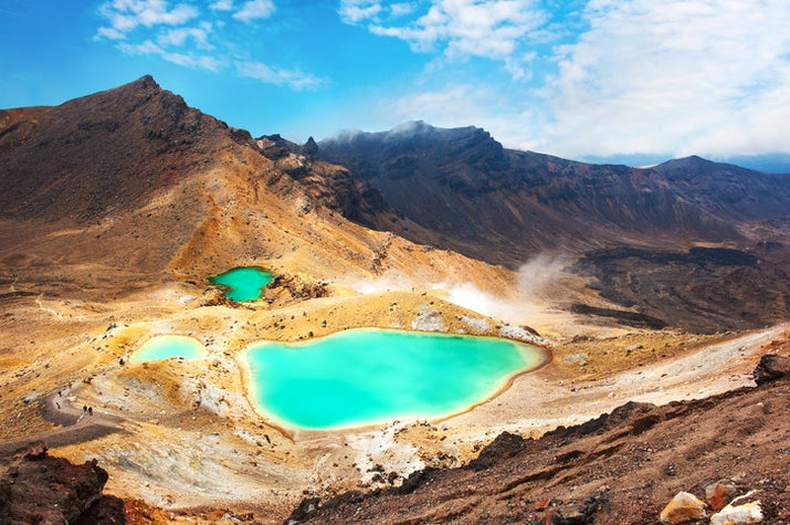 —andiekatherinesNew Zealand's oldest national park is home to mountains, volcanoes, hot springs, and jade lakes. The most popular attraction is a full-day trek across the hills of the three volcanoes encircled by the park.