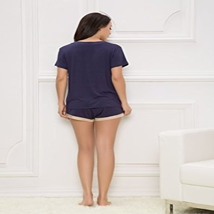 A model standing with her back to us, wearing the bamboo pajama set.