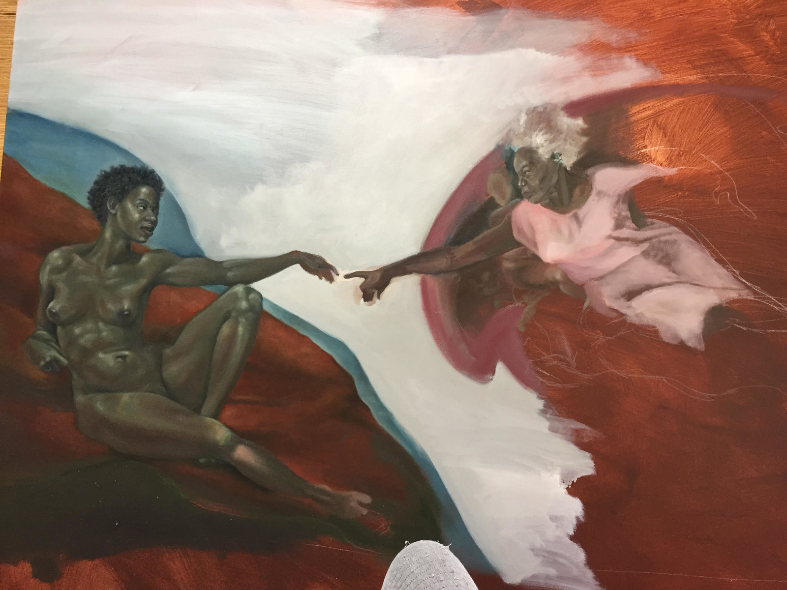 This artist re created the birth of adam with black for Creation of adam mural
