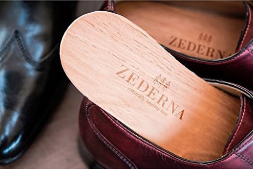 0199b52f39e5 A pair of cedarwood shoe insoles that ll absorb foot moisture so you never  have to worry about stinky shoes.