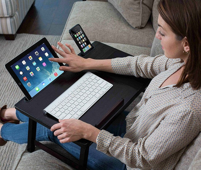 """Promising Review: """"This little tray is well-built, with legs that are very sturdy. The height is perfect for going over my legs when I'm sitting in a chair using my laptop. I love that it has a place for my phone and tablet, as well."""" —Amazon CustomerGet it from Amazon for $39.86 (available in three colors)."""