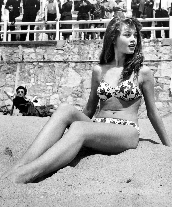 French actor Brigitte Bardot sunbathes on the beach during the Cannes Film Festival in 1953.