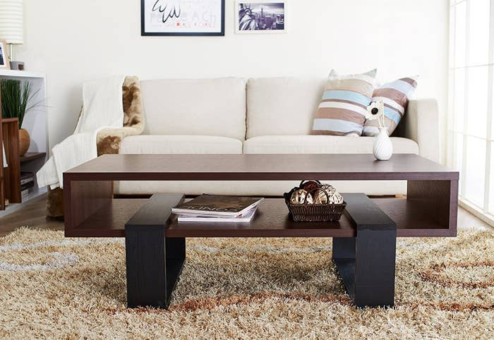 """Get it from Amazon for $140.84.Promising review: """"Absolutely love this coffee table. Very utilitarian. I can store a little throw blanket under or inside it as well as magazines, coasters, trays, even board games! It's very stable and sturdy; I've had it for a year now and it still looks good as new with no issues. Rest my feet on it often while playing video games, too. No water spot issues either; the wood looks the same as the day I got it. Only tricky part is the corners can be a tad pointy, so beware of that if you've got children in the house. Otherwise, great table at a great price."""" —Zaid Jamal"""