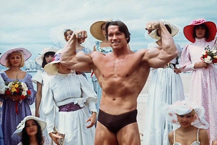 Arnold Schwarzenegger shows off his muscles during the 38th Cannes Film Festival in 1977, at which he presented the documentary Pumping Iron.