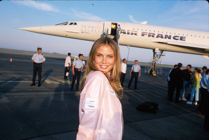 Model Heidi Klum poses in front of a Concorde jet after arriving for the Victoria's Secret Fashion Show at Cannes.