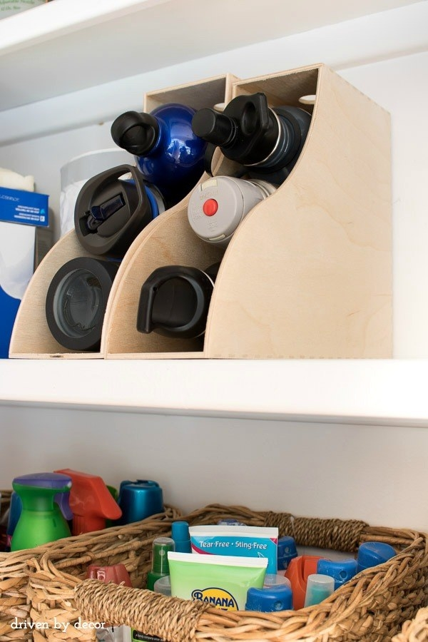 Store your most-used water bottles in repurposed magazine organizers.