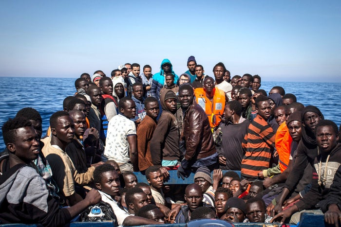 Refugees on a small wooden boat await rescue from by crew members from the Migrant Offshore Aid Station (MOAS) Phoenix vessel on May 18 off Lampedusa, Italy. The numbers of refugees attempting the dangerous central Mediterranean crossing from Libya to Italy has risen since the same time last year, with more than 43,000 people recorded so far in 2017.